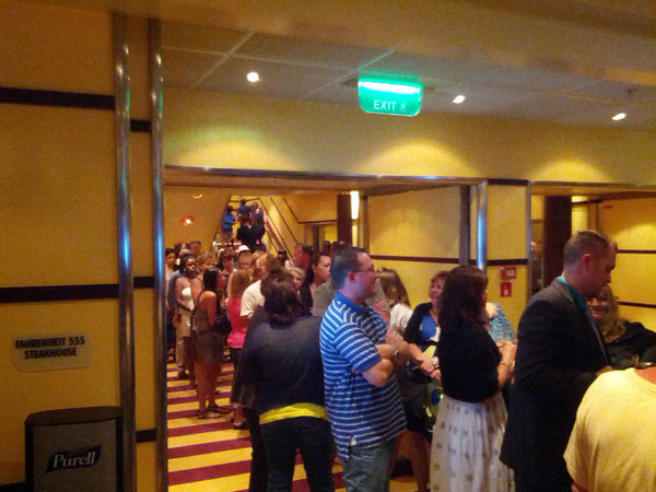 As soon as you leave a nice meal, be prepared to wade through a huge crowd. This only shows 1/4 of the line, the rest winds down Promenade deck...